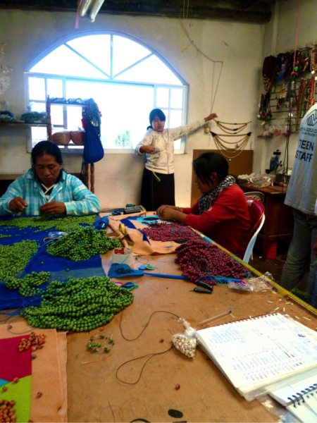 Artisan assistants working in workshop north of Otavalo, Ecuador